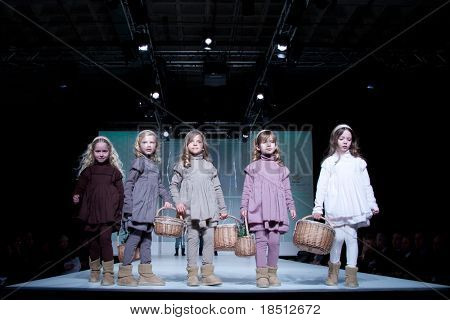 VALENCIA, SPAIN - JANUARY 21: Unidentified child models walk the runway at the FIMI Children's Winter Fashion Show for designer Loran Jinha in the Feria Valencia on January 21, 2011 in Valencia, Spain.