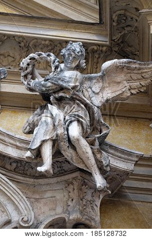 ROME, ITALY - SEPTEMBER 05: Angel on facade of Santa Maria Maddalena Church in Rome, Italy on September 05, 2016.