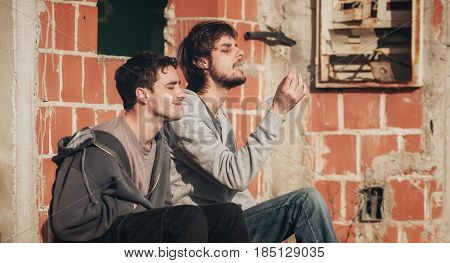 Friends Smoke Marihuana Or Hashish Joint In Underground Ghetto Neighborhood