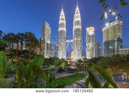 KUALA LUMPUR MALAYSIA - AUGUST 13: Petronas Twin Towers in blue hour on August 13, 2016 in Kuala Lumpur. Petronas Twin Towers were the tallest buildings (452 m) in the world from 1998 to 2004