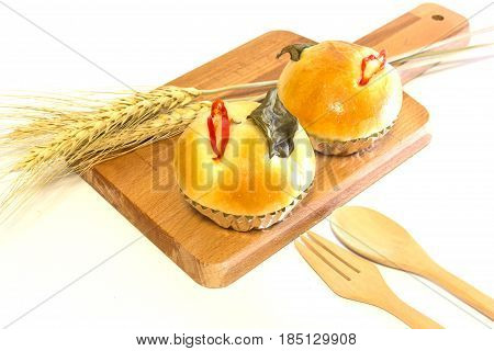 Chicken Green Curry bread on wooden plate isolated on a white background