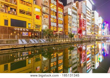 OSAKA, JAPAN - APRIL 12, 2015: The Dotonbori Canal in the Namba District. The canals date from the early 1600's and are a popular nightlife destination.