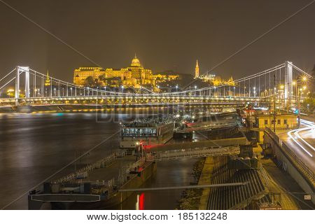 Top view from the Pest side of the Elisabeth Bridge and Buda castle background in Budapest at night.