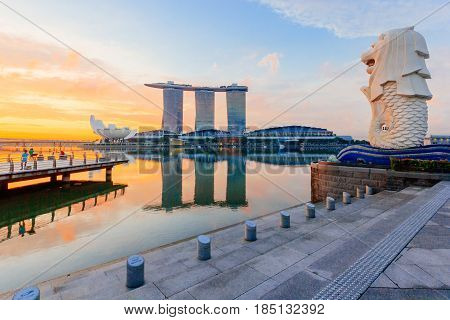 SINGAPORE - MAY 15, 2016: The Merlion and the Marina Bay Sands Resort Hotel billed as the world's most expensive standalone casino property at S$8 billion on May 15, 2016 in Singapore.