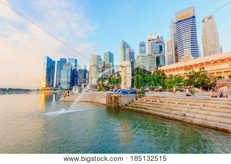 SINGAPORE - MAY 15 2016: View of Singapore Merlion at Marina Bay against Singapore skyline. Merlion is a well-known tourist icon mascot and national personification of Singapore