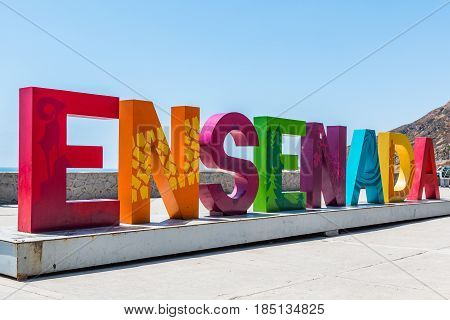 ENSENADA, MEXICO - MAY 3, 2017:  The city name of Ensenada greets visitors in giant colorful letters on arrival to this coastal city, which is the third largest in Baja California.