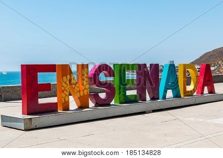 ENSENADA, MEXICO - MAY 3, 2017:  A giant colorful sign welcomes visitors to Ensenada, a coastal Mexican city located only 80 miles south of San Diego in Baja California.