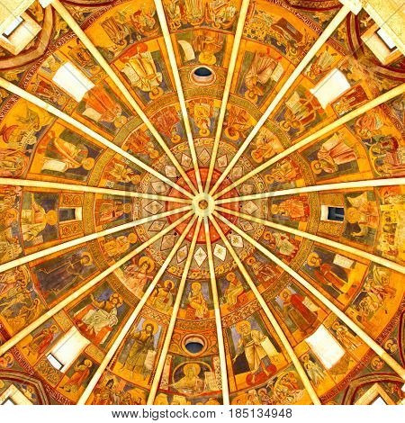 Parma, Italy - October 15, 2016: Ancient ceiling fresco in the Baptistery of Parma