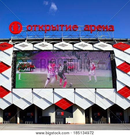 Moscow, Russia - May 03, 2017: Facade of Otkrytie Arena Stadium (Spartak Stadium) with big screen in Moscow