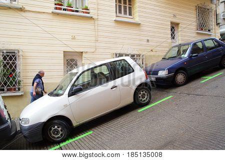 Barcelona, Spain - June 10, 2011: Uphill street with parking lot on a slant in Barcelona
