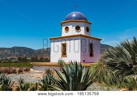 ENSENADA, MEXICO - MAY 3, 2017:  Domed building overlooking the vineyards of the Adobe Guadalupe Winery in Baja California.