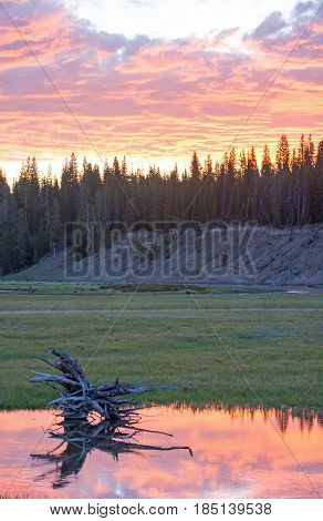 Early morning Sunrise clouds over Pelican Creek in Yellowstone National Park in Wyoming USA