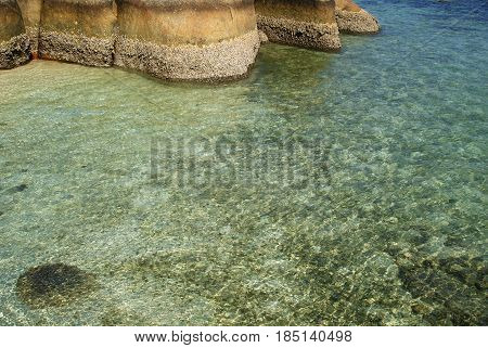 Natural granite rock formation in the clearly beach