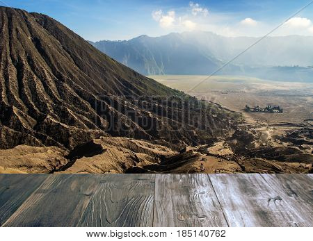 vintage wood terrace with view of volcano mountain bromo in Tengger Semeru National Park East Java Indonesia soft focus selective focus copy space.
