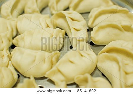 Momo type of South Asian dumpling; native to Tibet Nepal Bhutan and Sikkim. It is similar to Chinese baozi and jiaozi Mongolian buuz Japanese gyoza and Korean mandu. Stock photograph.