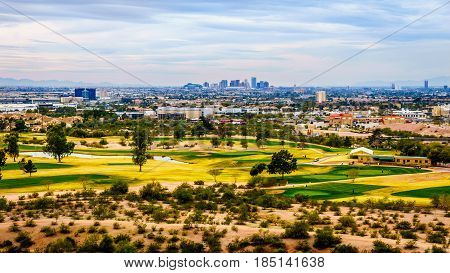 The city of Phoenix in the valley of the Sun seen from the Red Sandstone Buttes in Papago Park in Arizona, USA