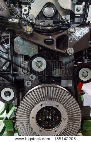 Fragment of the old internal combustion engine close-up. Background.