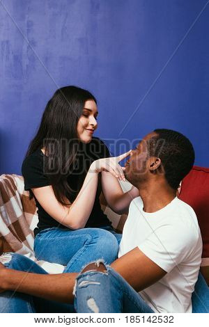 Man and woman in love, interracial relationship. Happiness, joy, caress and gentle touch, happy international couple concept.
