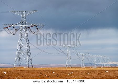 extreme high voltage power transmission towers on tibet plateau powerful energy background