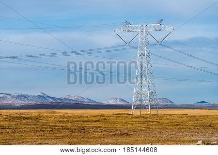 powerful electric power pylon closeup on tibetan plateau