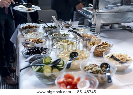 Variety of fresh salads bowls on a buffet table business dinner