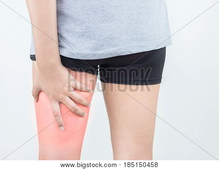 Young woman with pulled hamstring. Hamstring pain after sport playing.