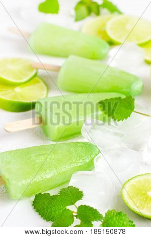 Healthy lime mint popsicles with fresh lime slices And ice cubes. Selective focus
