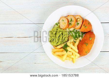 French Fries, Mashed Pea And Chicken Cutlets