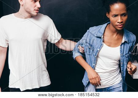 Couple breakup, black woman and white man relationship problem, end of being together. Guy stop partner, don't go. Divorce, quarrel, domestic violence concept