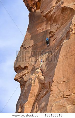Climbers on the rockwall of the Tower of Babel Arches National Park Utah USA