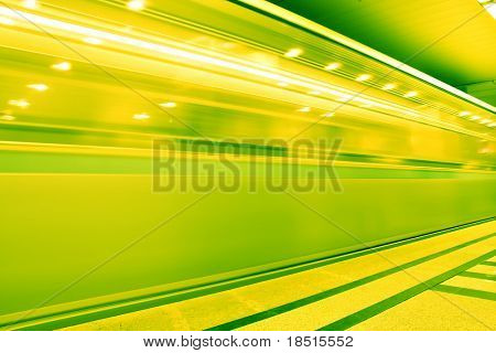 yellow fast moving train in motion