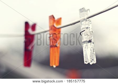 Clothes pegs outdoor in the summer rain