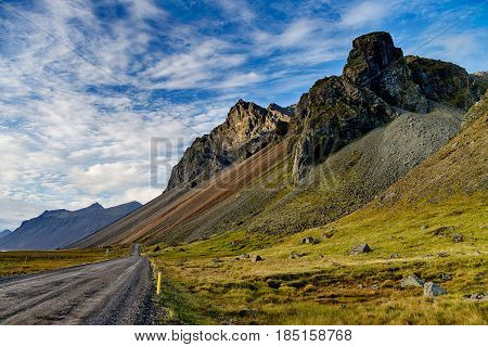 Dirt road in Iceland with big mountains