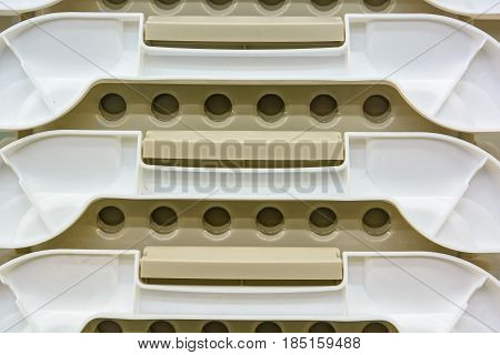 Close up pile of white plastic boxes
