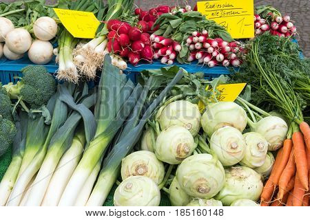 Leek, kohlrabi and other vegetables for sale at a market