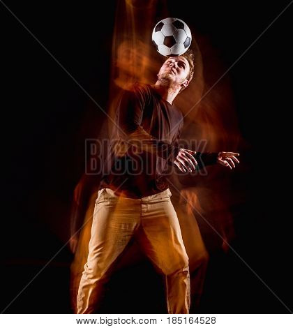A portrait of a fan with ball on gray studio background. Freestile concept. Stroboscope shooting technique poster
