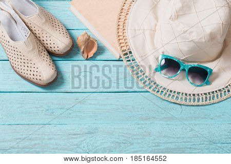 the summer background with sunglass and hat