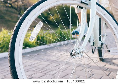 Close-up Of Vintage Bicycle Wheels With White Tires And Reflector