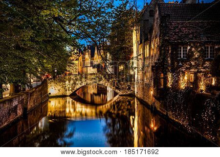 Night view of Bruges city, Belgium, nightshot of Brugge canals, traditional belgium architecture