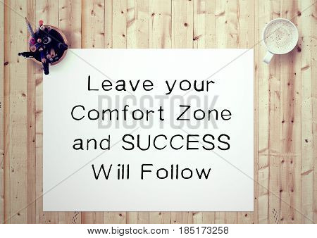 Inspiring motivation quote handwritten on a notepad leave your comfort zone and success will follow. White pad paper image.