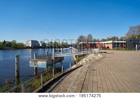 MAGDEBURG, GERMANY - APRIL 19, 2017: Waterfront promenade on the river Elbe in Magdeburg. The promenade is one of the most popular destinations in summe