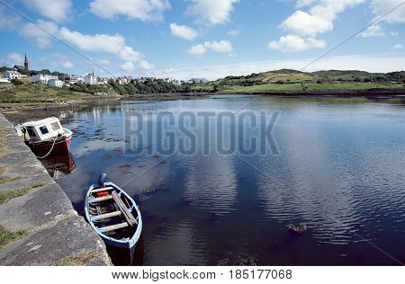 Bay of Clifden : sea village and reflections of dappled sky in Connemara Ireland