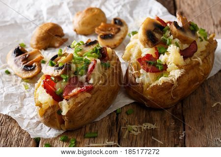 Hearty Hot Baked Potatoes With Bacon, Mushrooms, Onions And Cheese Close-up. Horizontal