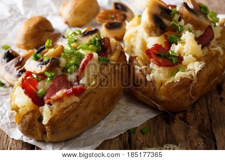 Slowly Baked Potatoes With Bacon, Mushrooms And Cheese Close-up. Horizontal