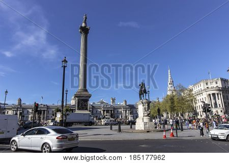 London United Kingdom - 9th of April 2017: Tourists walking around Trafalgar Square on one of the first sunny and warm days of the year.