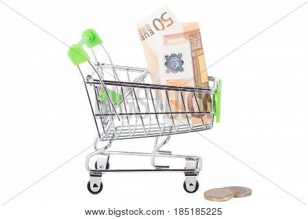 Fifty euro in the shopping pushcart isolated on white