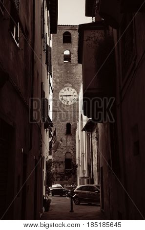 Lucca street view with Santa Maria del Carminein bell tower in Italy