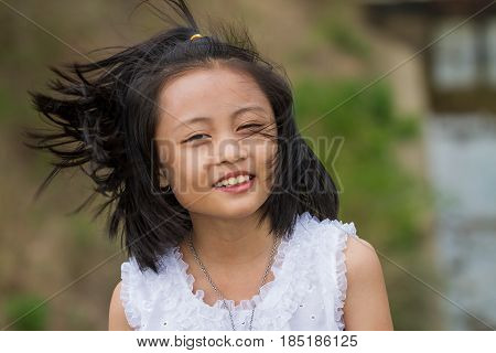 Thai girl play around whit traditional Thai costume