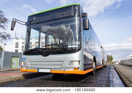 a german bus stands on a street