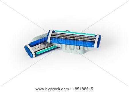 two razor blades on a white background closeup